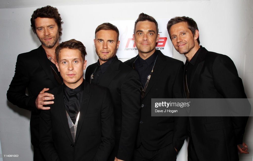 L-R Howard Donald, Mark Owen, Gary Barlow, Robbie Williams and Jason Orange of Take That pose backstage prior to performing at the National Movie Awards 2011 at Wembley arena on May 11, 2011 in London, England.