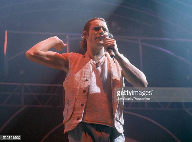 Howard Donald of Take That performing on stage at the Wembley Arena in London circa July 1993