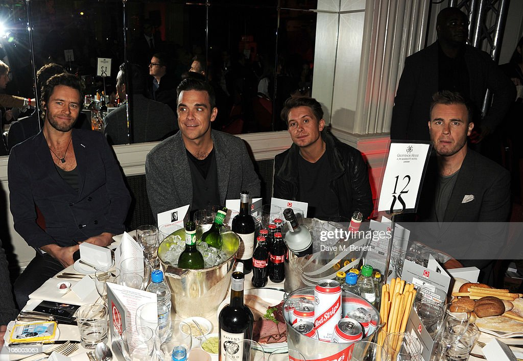 Howard Donald, Robbie Williams, Mark Owen and Gary Barlow of Take That attend The Q Awards 2010 at the Grosvenor House on October 25, 2010 in London, England.