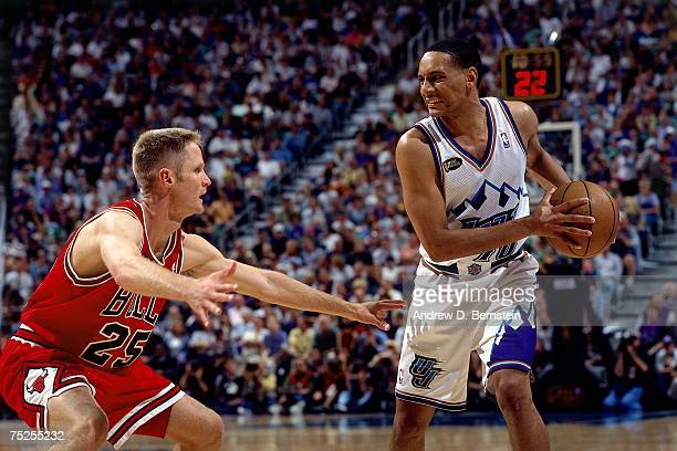 Howard Eisley of the Utah Jazz looks to make a move against Steve Kerr of the Chicago Bulls in Game Six of the 1998 NBA Finals at the Delta Center on...
