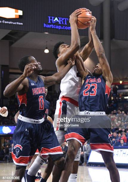 Howard forward Jalen Jones and Gonzaga forward Rui Hachimura end up with a held ball on this rebound during the game between Gonzaga and Howard on...