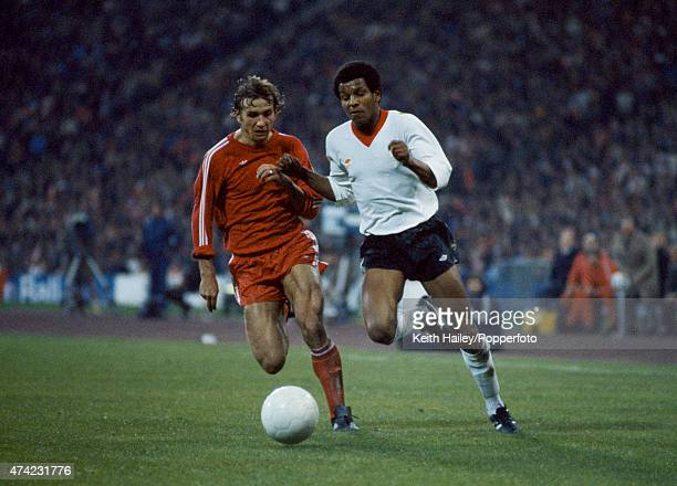 Howard Gayle of Liverpool moves past Wolfgang Dremmler of Bayern Munich during the European Cup SemiFinal 2nd leg at the Olympic Stadium in Munich...
