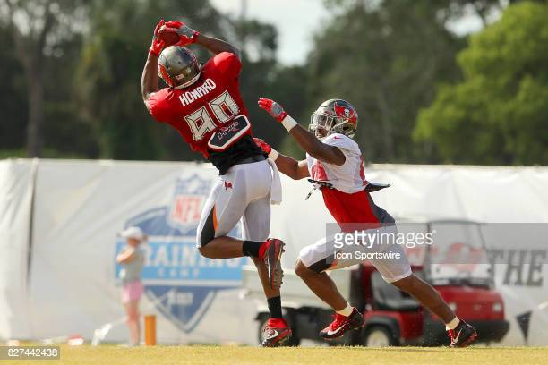 Howard goes up high to make a catch over linebacker Devante Bond during the Tampa Bay Buccaneers Training Camp on August 2017 at One Buccaneer Place...