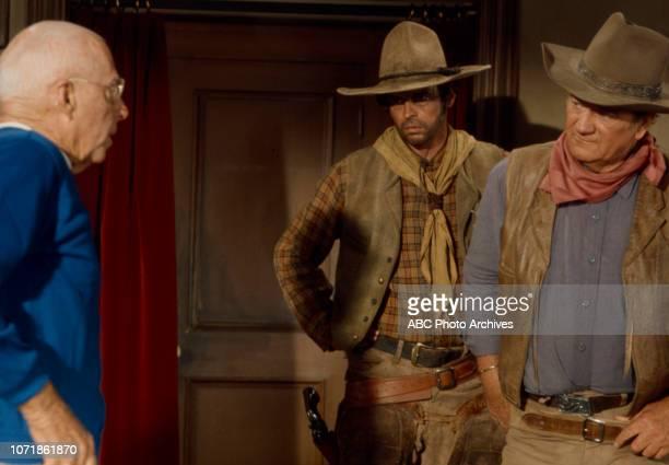 Howard Hawks George Plimpton John Wayne behind the scenes of the making of 'Rio Lobo' for the Walt Disney Television via Getty Images special...