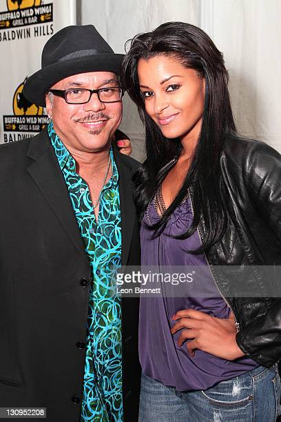 Howard Hewett and Claudia Jordan backstage at the Trevor Ariza Foundation All Star Gala Inaugural Grand Opening of Buffalo Wild Wings Grill Bar at...