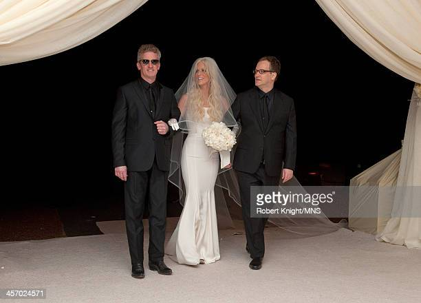 Howard Holt and Glen Holt walk their sister Michaele Schon down the aisle at her wedding to Neal Schon at the Palace of Fine Arts on December 15 2013...