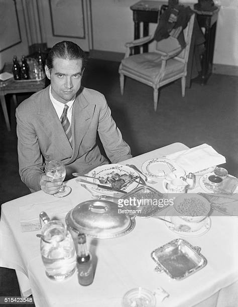 Howard Hughes enjoys a hearty breakfast in his room at the Waldorf Astoria after flying across the continent from Los Angeles to Newark in the record...