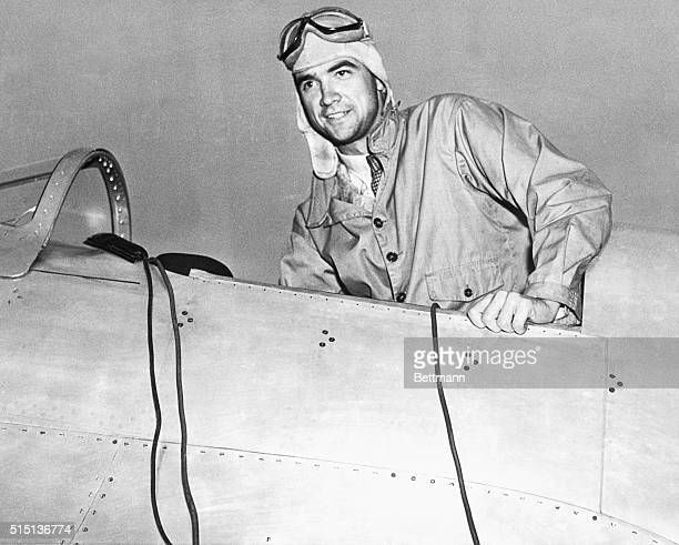 Howard Hughes in the cockpit of an airplane in a leather flight helmet and goggles