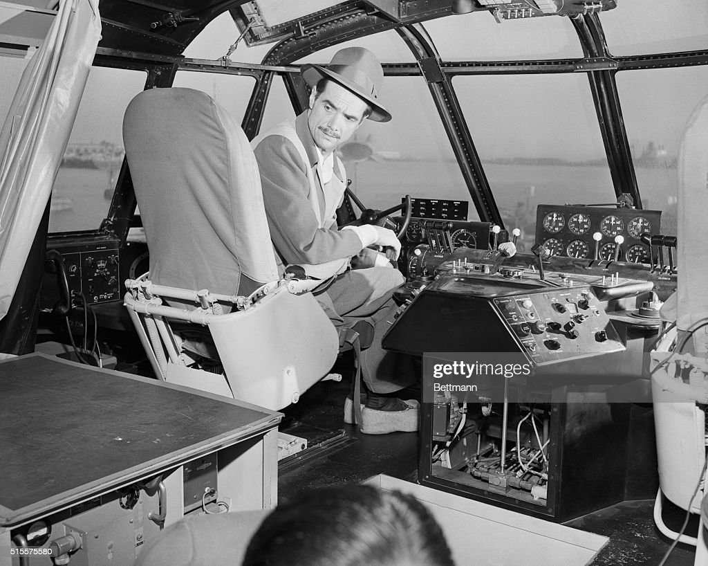 Howard Hughes in Cockpit of Spruce Goose : News Photo
