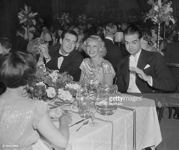 Howard Hughes millionaire movie producer and avid aviator sitting at dinner table with some of his Hollywood friends Left to right Pat DeCicco June...