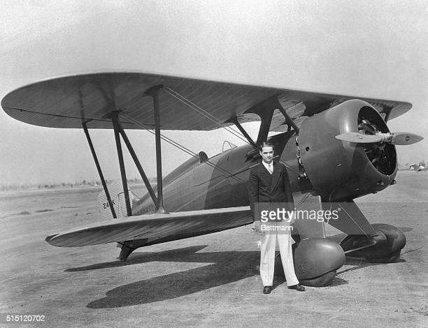Howard Hughes motion picture producer shown after a test hop in his new high powered plane a Boeing Army pursuit ship Hughes is said to be the only...