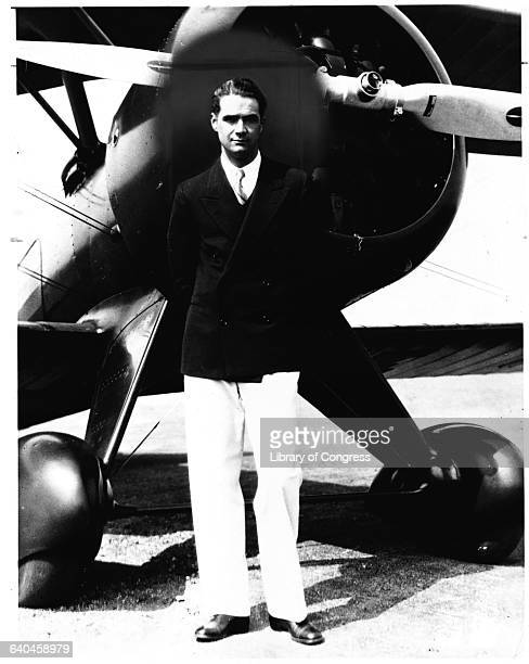 Howard Hughes standing in front of his new Boeing Army Pursuit Plane in Inglewood California