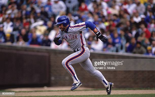 Howard Johnson of the New York Mets runs the bases during a game against the Chicago Cubs on September 22 1990 in Chicago Illinois