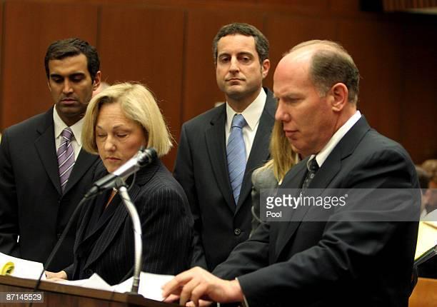 Howard K Stern longtime confidant of Anna Nicole Smith and Dr Sandeep Kapoor look on as their lawyers Steven H Sadow and Ellyn S Garofalo speak...