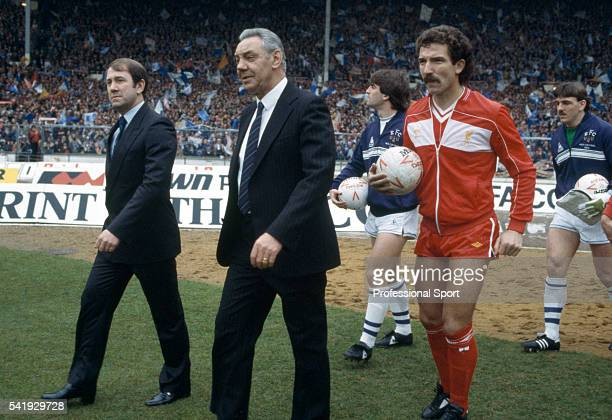 Howard Kendall of Everton and Joe Fagan of Liverpool lead their teams out at Wembley Stadium in London prior to the Football League Cup Final...