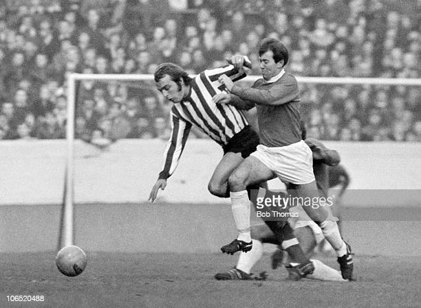 Howard Kendall of Everton challenges Ron Davies of Southampton during their Division One match held at Goodison Park Everton on 12th December 1970