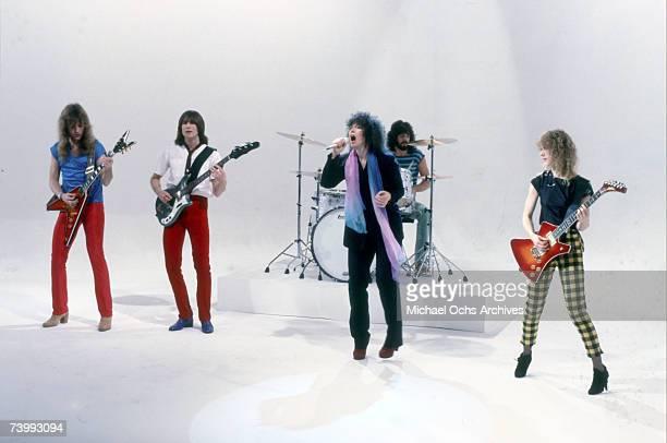 "Howard Leese, Steve Fossen, Ann Wilson, Michael Derosier, and Nancy Wilson of the rock and roll band ""Heart"" in a film still from a music video in..."