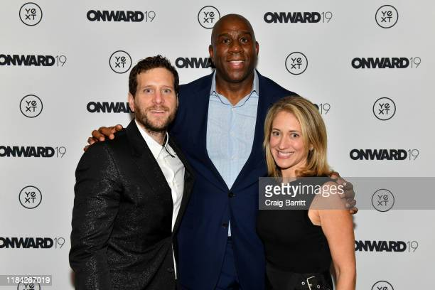 "Howard Lerman, Earvin ""Magic"" Johnson and Wendy Lerman pose during ONWARD19: The Future Of Search - Day 2 at Marriott Marquis Times Square on October..."