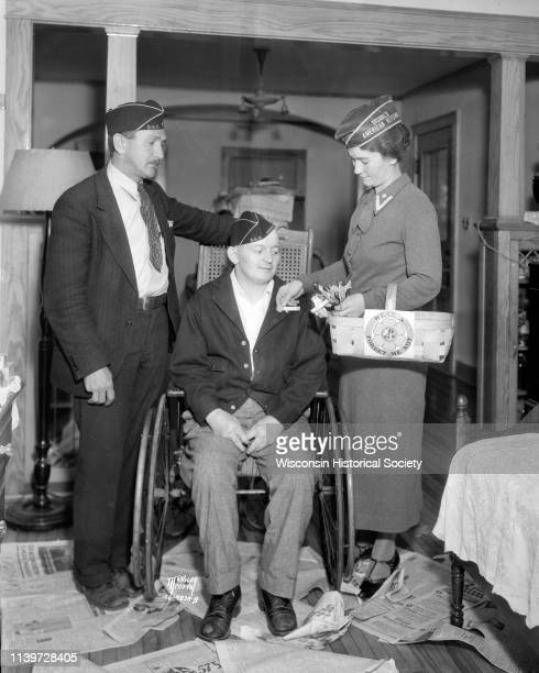 Howard Miner disabled World War I veteran receiving Forgetmenot flower from Florence Palz ladies auxiliary chairman marking the opening of the...