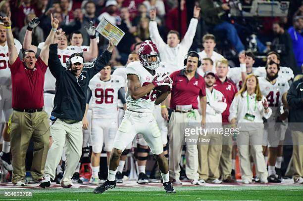 J Howard of the Alabama Crimson Tide catches a pass to run 53 yards for a touchdown in the third quarter against the Clemson Tigers during the 2016...