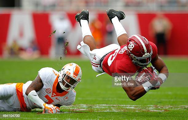 J Howard of the Alabama Crimson Tide dives for more yardage as he is tackled by Cameron Sutton of the Tennessee Volunteers at BryantDenny Stadium on...