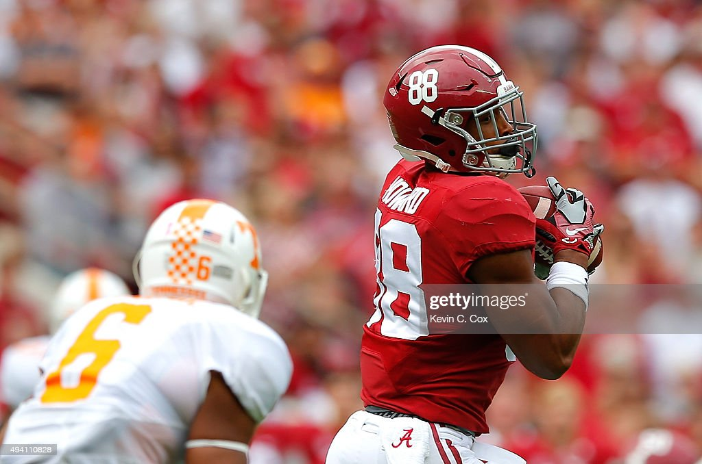 O.J. Howard #88 of the Alabama Crimson Tide pulls in this reception against Todd Kelly Jr. #6 of the Tennessee Volunteers at Bryant-Denny Stadium on October 24, 2015 in Tuscaloosa, Alabama.