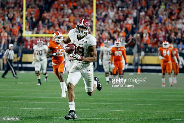J Howard of the Alabama Crimson Tide runs the ball after catching a pass to score a 51 yard touchdown in the fourth quarter against the Clemson...