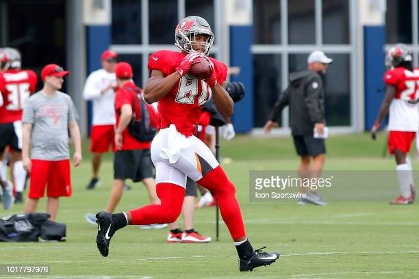 O J Howard of the Bucs catches a pass during the joint training camp work out between the Tampa Bay Buccaneers and the Tennessee Titans on August 16...