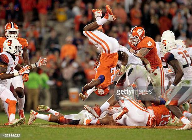J Howard of the Clemson Tigers flips over a defender during the game against the Syracuse Orange at Memorial Stadium on October 25 2014 in Clemson...