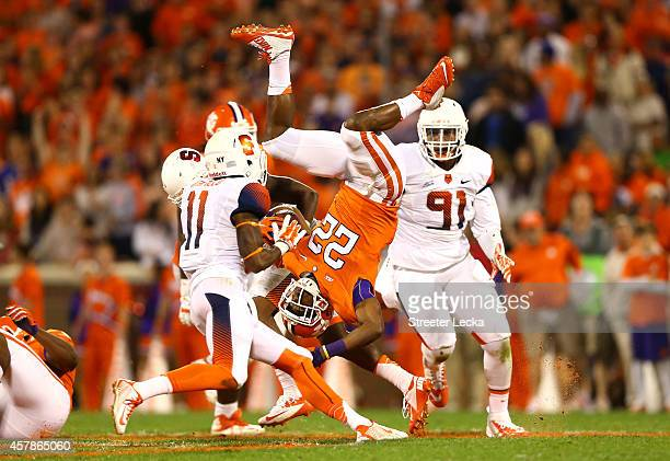 J Howard of the Clemson Tigers flips over Darius Kelly of the Syracuse Orange after a hit during their game at Memorial Stadium on October 25 2014 in...
