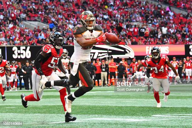 J Howard of the Tampa Bay Buccaneers catches a pass during the fourth quarter against the Atlanta Falcons at MercedesBenz Stadium on October 14 2018...