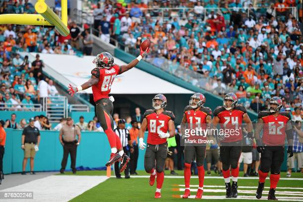 J Howard of the Tampa Bay Buccaneers celebrates after scoring a touchdown during the second quarter against the Miami Dolphins at Hard Rock Stadium...