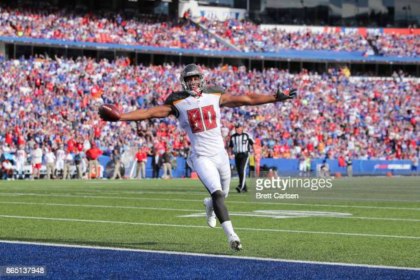 J Howard of the Tampa Bay Buccaneers celebrates while scoring a touchdown in the third quarter of an NFL game against the Buffalo Bills on October 22...