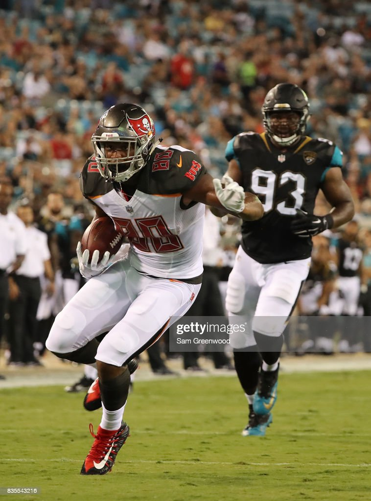 O.J. Howard #80 of the Tampa Bay Buccaneers runs for yardage during a preseason game against the Jacksonville Jaguars at EverBank Field on August 17, 2017 in Jacksonville, Florida.