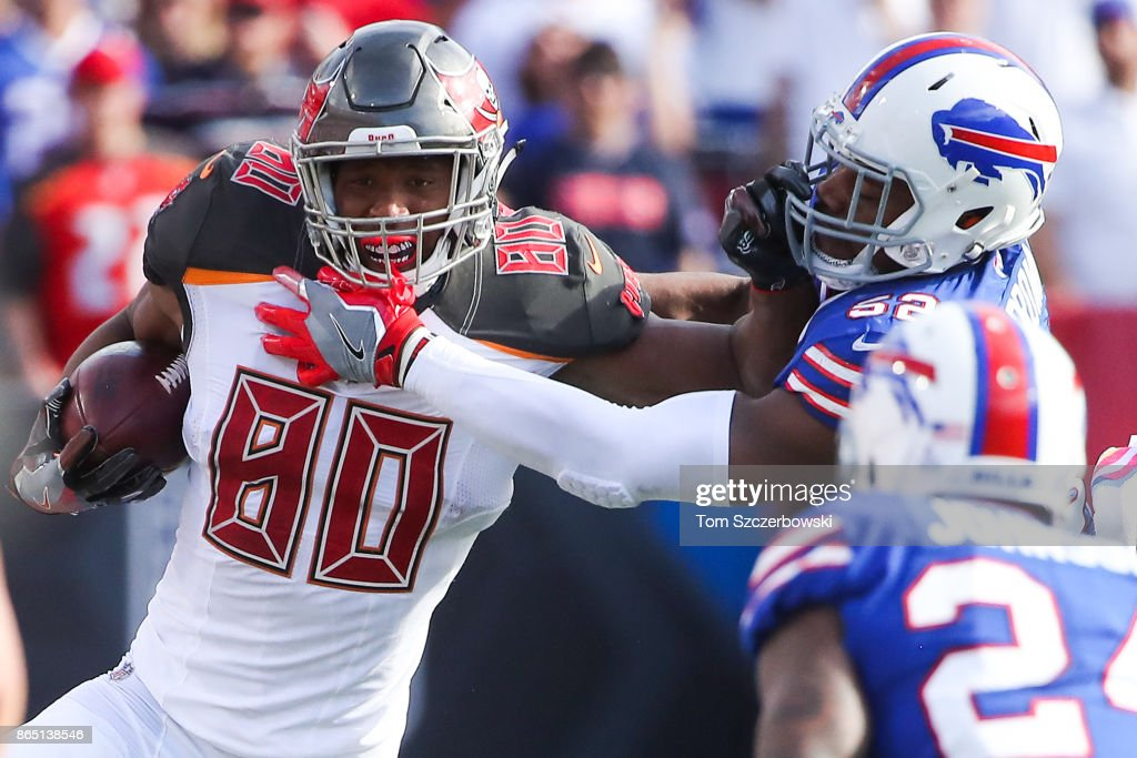 O.J. Howard #80 of the Tampa Bay Buccaneers runs the ball as Preston Brown #52 of the Buffalo Bills attempts to tackle him during the third quarter of an NFL game on October 22, 2017 at New Era Field in Orchard Park, New York.