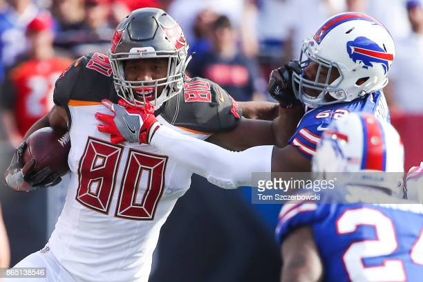 J Howard of the Tampa Bay Buccaneers runs the ball as Preston Brown of the Buffalo Bills attempts to tackle him during the third quarter of an NFL...