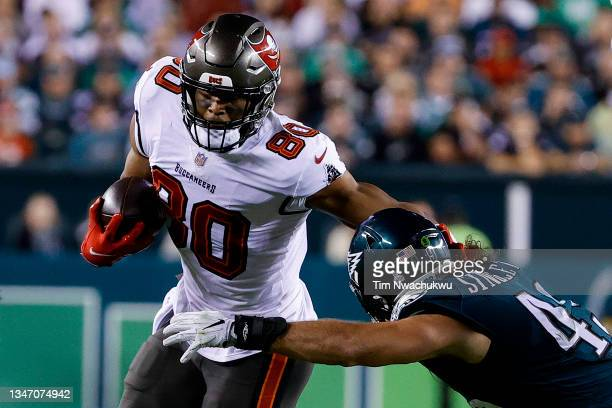 Howard of the Tampa Bay Buccaneers stiff arms Alex Singleton of the Philadelphia Eagles at Lincoln Financial Field on October 14, 2021 in...