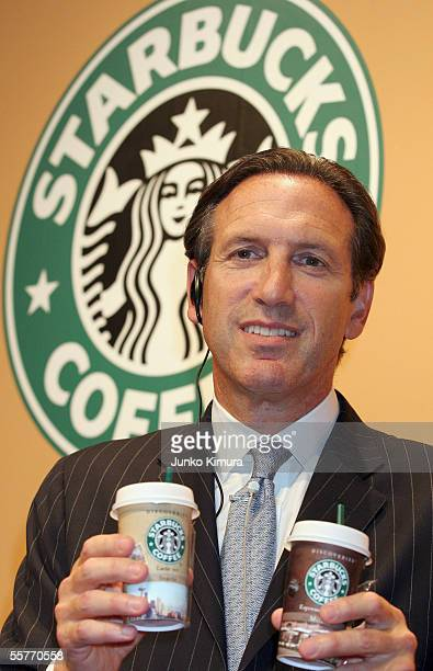 Howard Schultz Chairman Starbucks Coffe Company holds the company's new product Starbucks Discoveries during a preview party on September 26 2005 in...