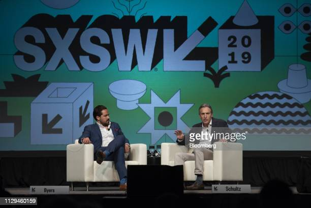 Howard Schultz former chief executive officer of Starbucks Corp right speaks as Dylan Byers senior media reporter at NBC News listens during the...