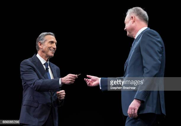 Howard Schultz hands over the key to the original Starbucks store to President and Chief Operating Officer Kevin Johnson during the Starbucks annual...