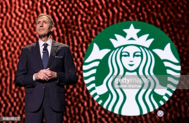 Howard Schultz pauses while speaking during the Starbucks annual meeting of shareholders on March 22 2017 in Seattle Washington The 25th annual...