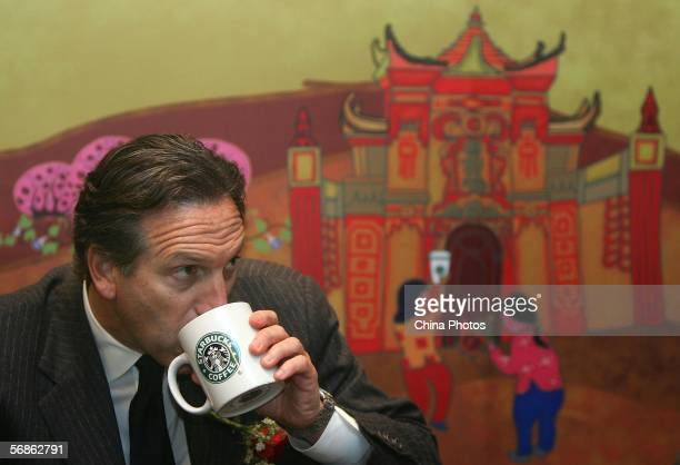 Howard Schultz president of the US Starbucks coffee chain drinks a cup of coffee in the first Starbucks store on February 16 2006 in Chongqing...