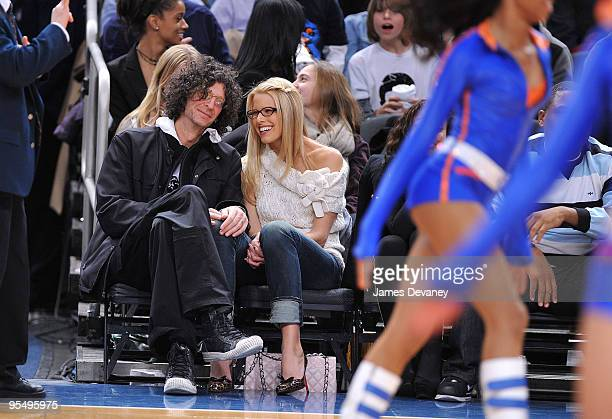 Howard Stern and Beth Ostrosky attend the Los Angeles Clippers vs New York Knicks game at Madison Square Garden on December 18, 2009 in New York City.