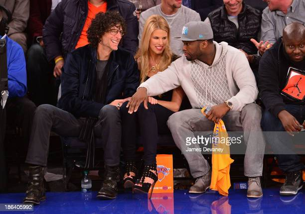 Howard Stern Beth Ostrosky and 50 Cent attend the Milwaukee Bucks vs the New York Knicks at Madison Square Garden on October 30 2013 in New York City