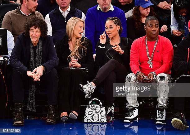 Howard Stern Beth Ostrosky Megan Wollover and Tracy Morgan attend Cleveland Cavaliers vs New York Knicks game at Madison Square Garden on December 7...
