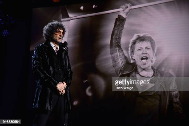 Howard Stern inducts Bon Jovi on stage during the 33rd Annual Rock & Roll Hall of Fame Induction Ceremony at Public Auditorium on April 14, 2018 in...