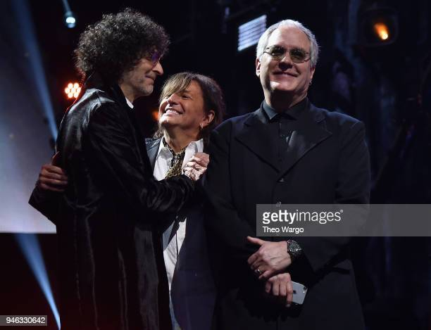 Howard Stern inducts Richie Sambora and Hugh McDonald of Bon Jovi on stage during the 33rd Annual Rock & Roll Hall of Fame Induction Ceremony at...