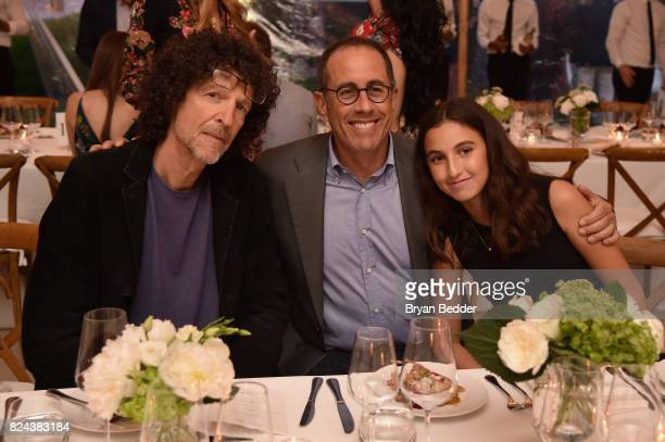 Howard Stern Jerry Seinfeld and Sascha Seinfeld attend The GOOD Foundation's Hamptons Summer Dinner cohosted by NETAPORTER on July 29 2017 in East...