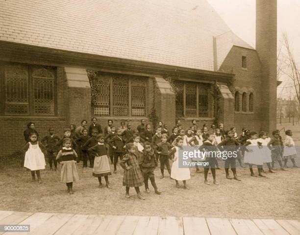 Howard Univ Washington DC ca 1900 elementary school students exercise