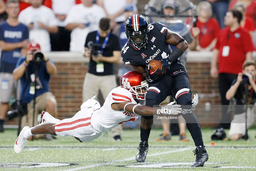 Howard Wilson #6 of the Houston Cougars makes a tackle against Nate Cole #84 of the Cincinnati Bearcats in the first half at Nippert Stadium on September 15, 2016 in Cincinnati, Ohio.